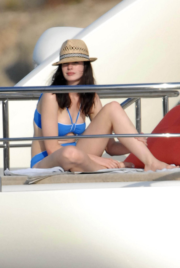 Anne Hathaway chilled in a blue bikini and straw hat during a trip to Portocervo, Italy, with then-boyfriend Raffaello Follieri in 2007.