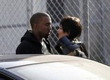Kim Kardashian and Kanye West looked sweetly at each other on set in LA.