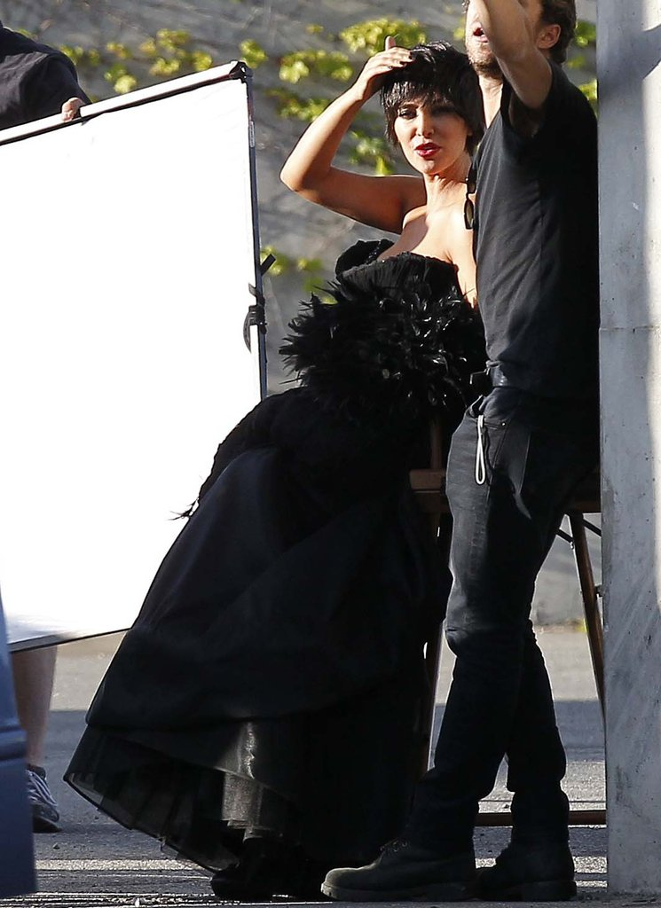 Kim Kardashian shaded her eyes while on set for her photo shoot.