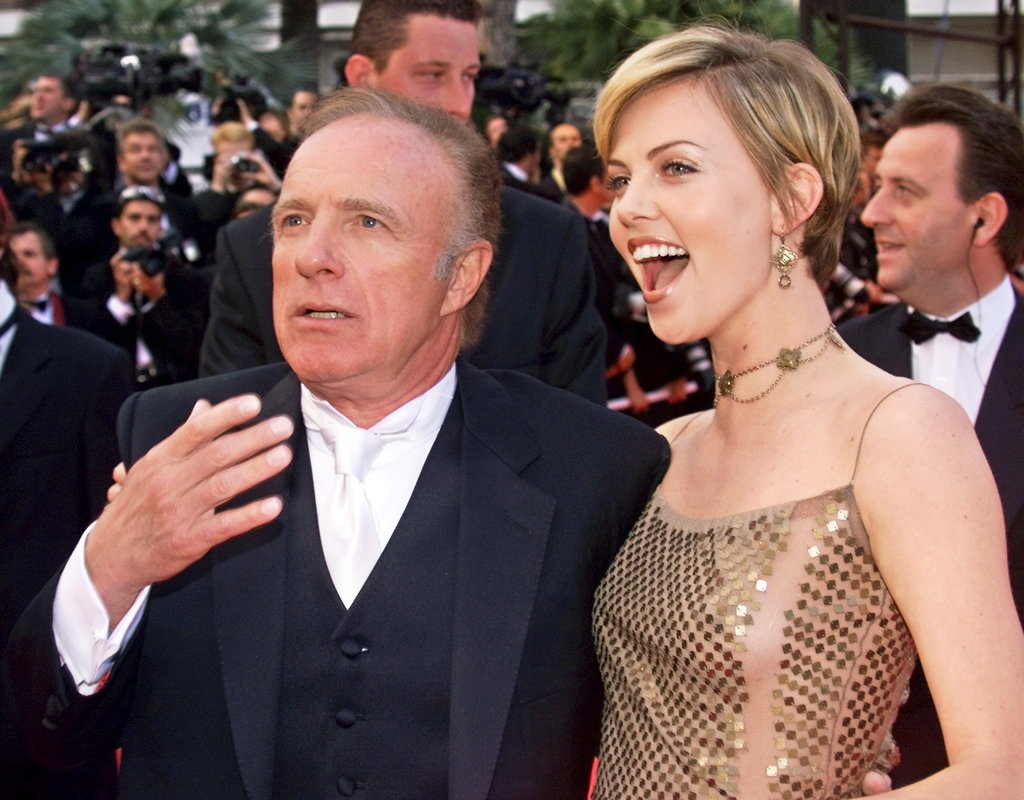 James Caan and Charlize Theron posed together at the Palais des Festivals for the closing ceremony of the Cannes Film Festival in 2000.