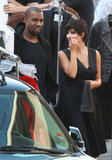 Kim Kardashian  and Kanye West stole a moment to chat on the set of the Vogue Italia photo shoot.