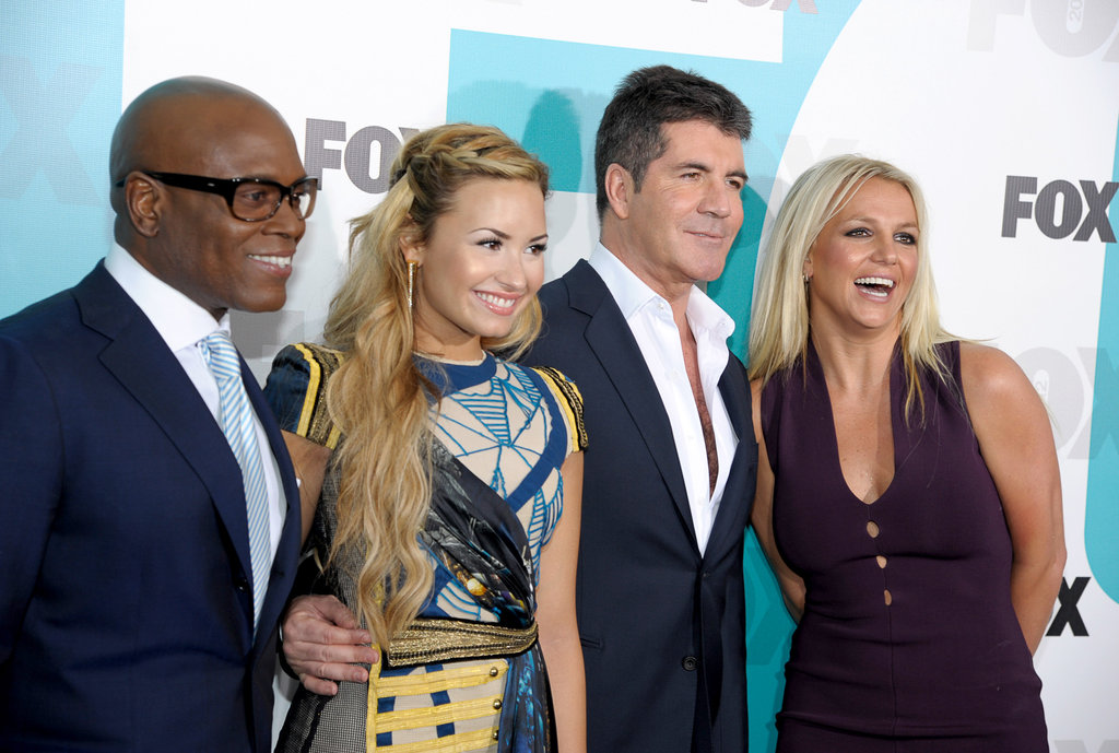 L.A. Reid, Demi Lovato, Simon Cowell, and Britney Spears laughed together at the Fox Upfronts party at a skating rink in Central Park.