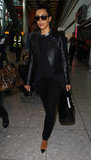 For her touchdown in London, Kim Kardashian sported a head-to-toe black look that included a black leather Valentino jacket, black J Brand trousers, Christian Louboutin cap-toe pumps, a chunky silver chain necklace, and Tom Ford shades.
