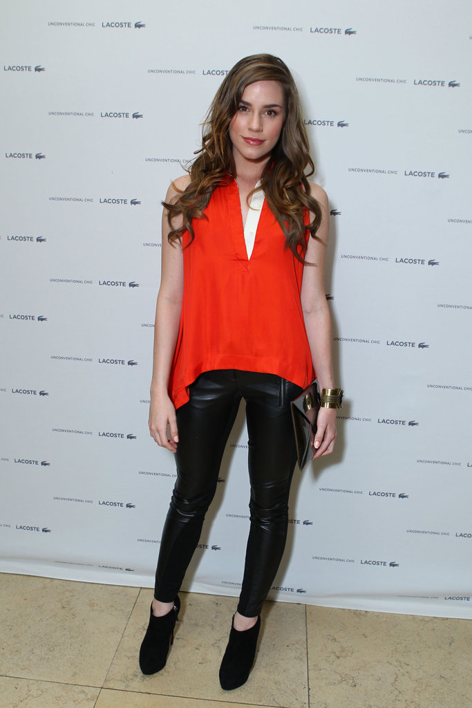 In March, Christa paired an eye-catching red blouse with edgy black leather pants.  6904834