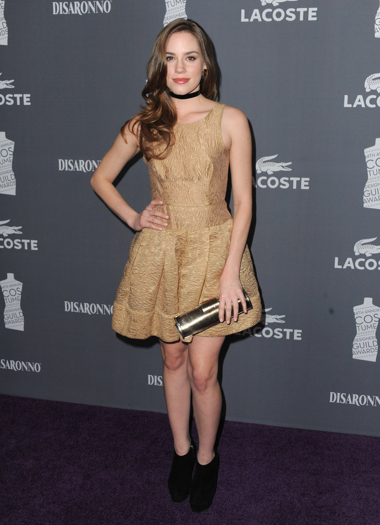 At the 2012 Costume Designers Guild Awards in February, Christa shined in a gold brocade dress, a black choker necklace, black booties, and a metallic clutch.  6904864