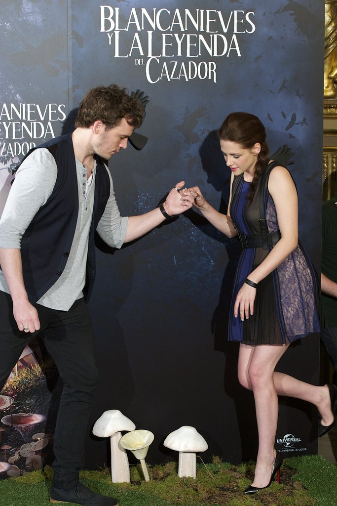 Sam Claflin helped Kristen Stewart onto the stage at the Snow White and the Huntsman photocall in Madrid.