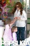 Isla Fisher played with daughters Elula and Olive.