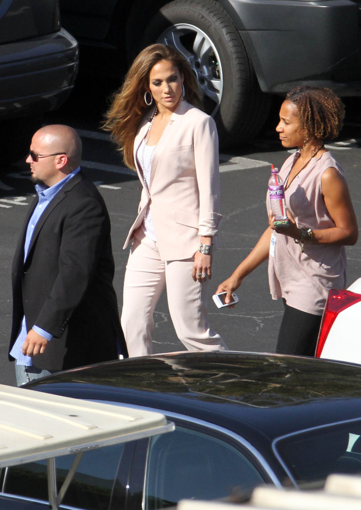 Jennifer Lopez walked with members of her team.