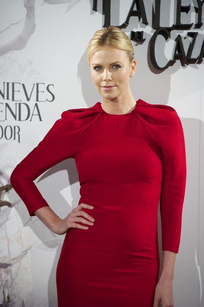 Charlize Theron gave a sexy smile for the Snow White and the Huntsman photocall in Madrid.