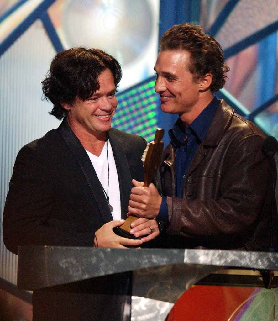 Matthew McConaughey presented John Mellencamp with the 2001 century award at the December show.