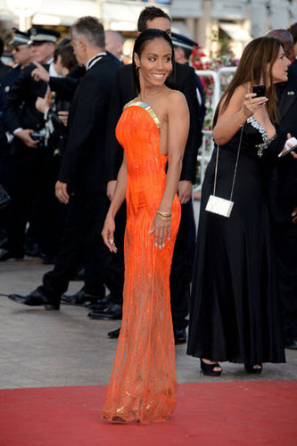 A full-length view of Jada Pinkett Smith's bright orange Atelier Versace gown at the Madagascar 3 premiere.