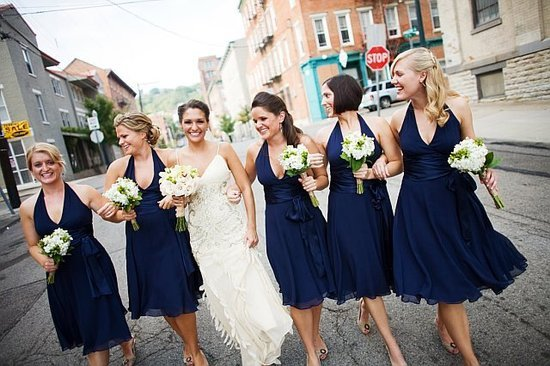 We love Fab reader emhanson's vintage-inspired slip-style wedding dress; not to mention, her bridesmaids look stellar in navy halter dresses!
