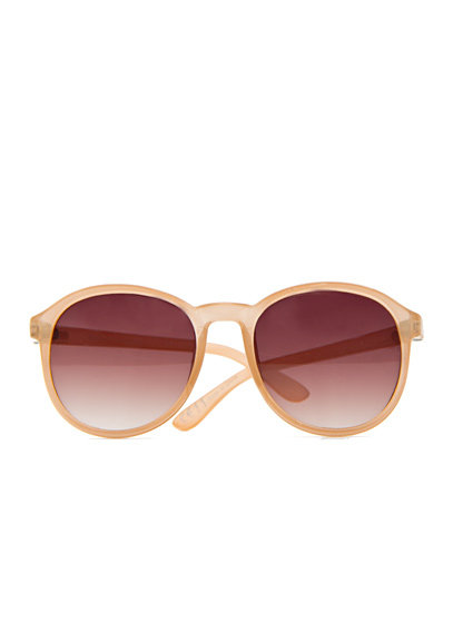 The soft pastel hue on these channels the on-trend style, but subtly so.  Mango Round Sunglasses ($25)