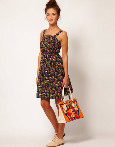 Add flat sandals and a skinny belt to complement this dress's retro feel.  River Island Floral Strappy Dress ($44)