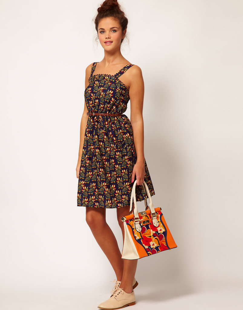 Add flat sandals and a skinny belt to complement this dress's retro feel. River Island Floral Strappy Dress ($25, originally $44)