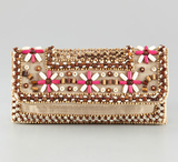 How gorgeous is this floral-beaded clutch? Pair it with an eyelet white dress or bright pink skirt to draw out the great color palette.  Moyna Floral-Bead Clutch ($145)