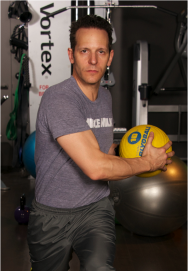 Lift your right leg slightly up and then bring it back into a lunge position, ensuring your body is in a straight line. As you lunge, hold a medicine ball in your hands and as your right leg goes back, twist the medicine ball to your waist on the left side.