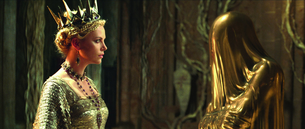 A gold figure offers cloaked advice to Ravenna. Photo courtesy of Universal Pictures