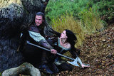 The huntsman brandishes his ax to protect Snow White. Photo courtesy of Universal Pictures