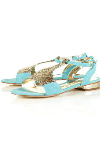 Wear these shiny mint sandals with cool shades for a coordinating, colorblocked look.  Topshop Hidden Mint Glitter Sandals ($60)