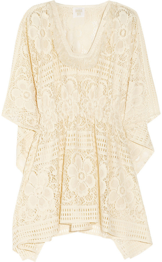 We want to live in this floral crochet tunic all season — pair it with denim cutoffs and a pair of metallic flat sandals. Anna Sui Floral Crochet Tunic ($295)