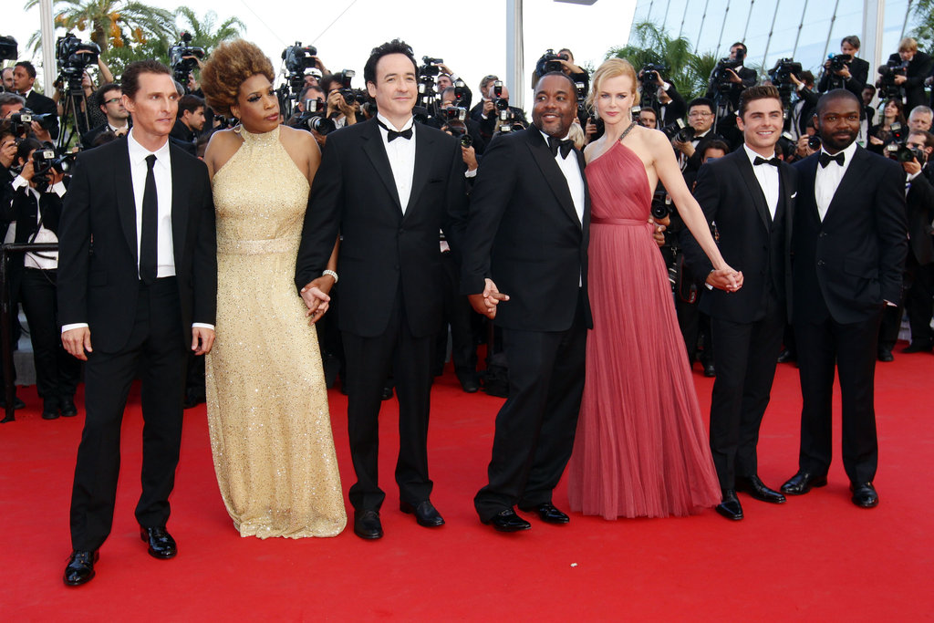 John Cusack and the rest of The Paperboy cast posed together on the red carpet.