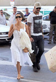 Eva Longoria was all smiles with Eduardo Cruz close behind as the couple caught a train in Spain.
