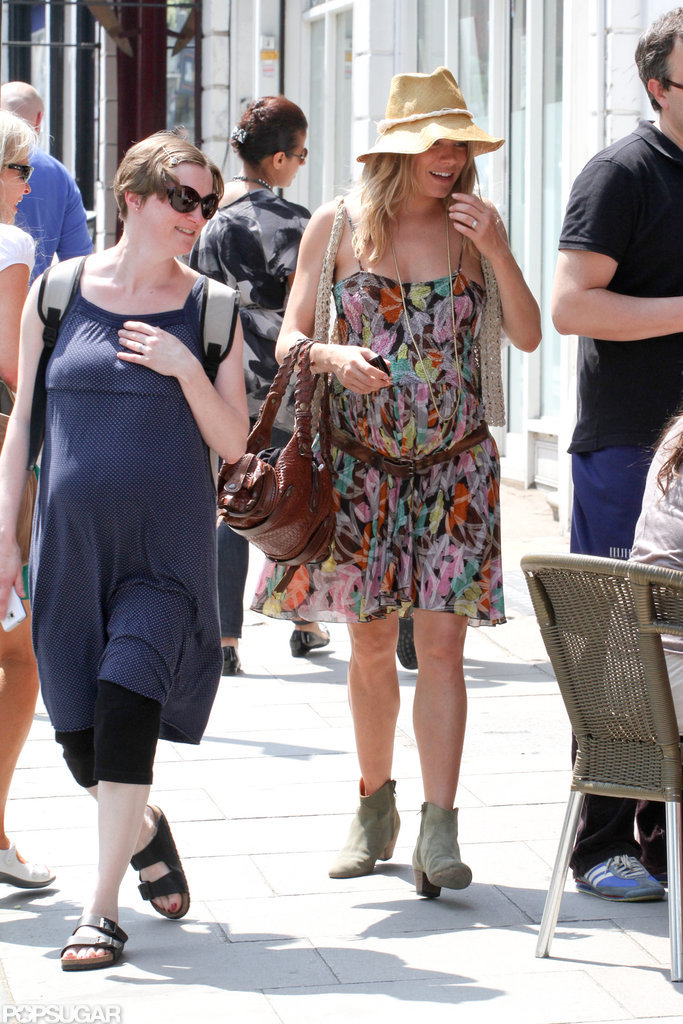 Sienna Miller and a friend chatted while walking through London.