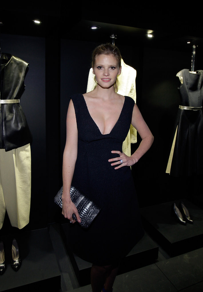 Lara Stone showed off her curves in a black dress at the event.
