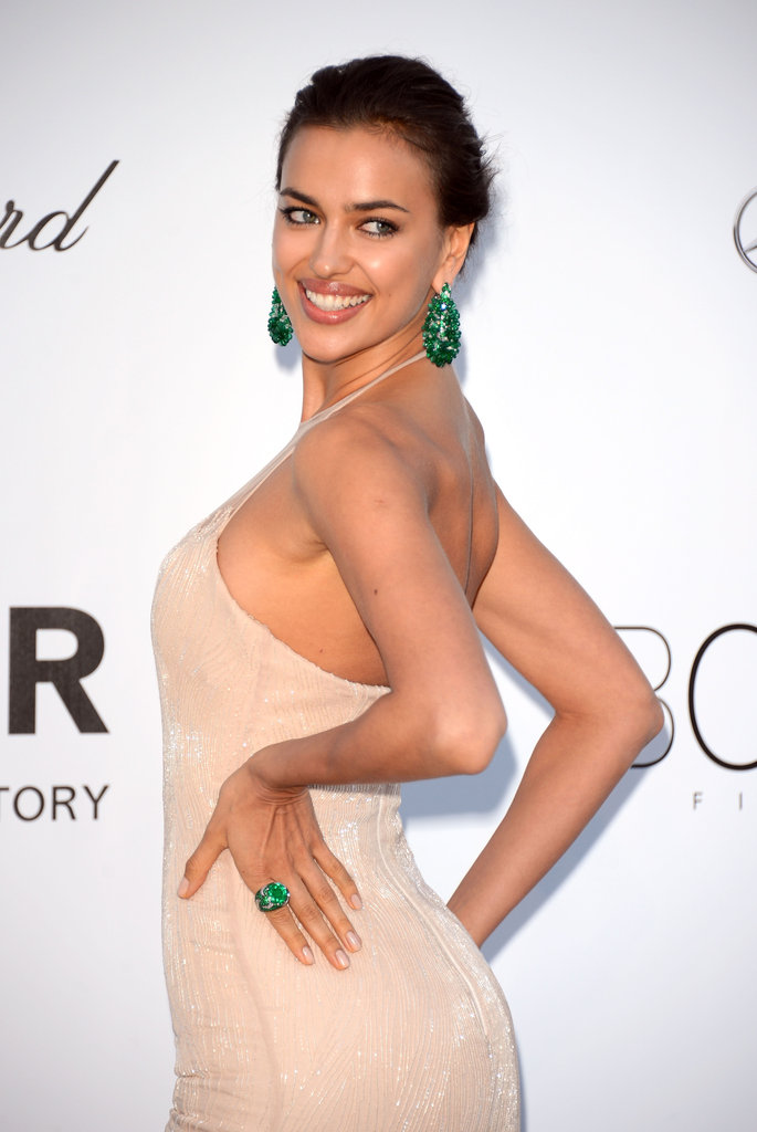 Irina Shayk posed in a nude Summer-perfect gown and accented her ensemble with gorgeous green jewels.