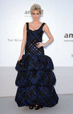 Kate Upton wore a supergirlie navy and black gown, complete with exaggerated ruffles at the hem, to the amfAR gala.