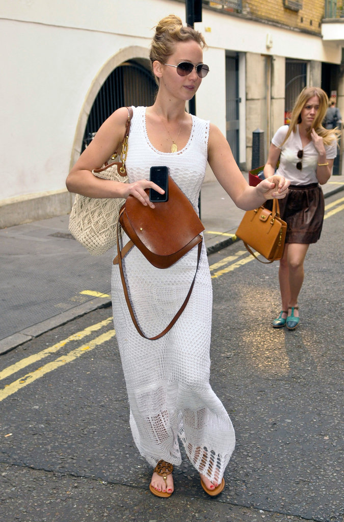 Earlier in the day, Jennifer was spotted wearing a white crochet maxi dress with Tory Burch sandals ($225), aviator sunglasses, Tory Burch's macramé Claire bag ($435), and a tan saddle bag.  6957857
