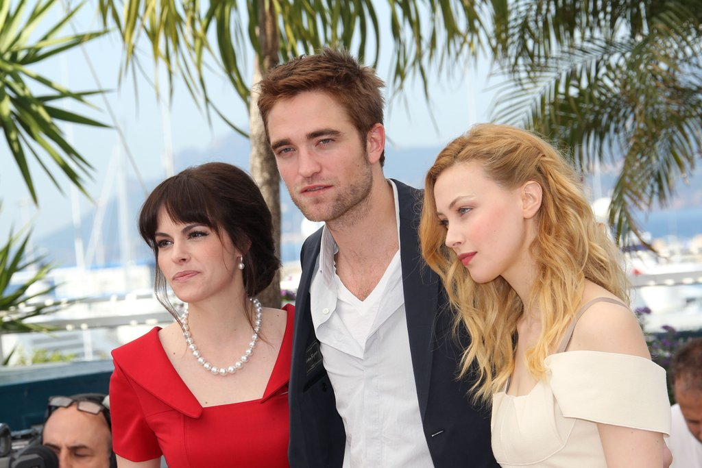 Robert Pattinson got between Sarah Gadon and Emily Hampshire at the Cosmopolis photocall in Cannes.