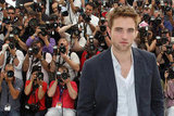 Robert Pattinson wore a blue blazer to the Cosmopolis photocall in Cannes.