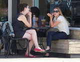 Lauren Conrad chatted with a friend at a table outside of Starbucks in LA.