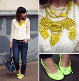Going for a refined take on lace? Pair a bright statement necklace and neon-hued flats for two pops of color against one perfect lace top. Photo courtesy of Lookbook.nu