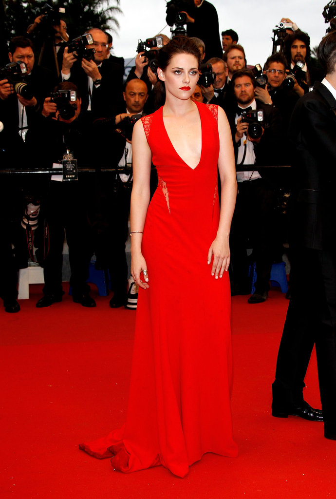 Kristen Stewart posed in jaw-dropping Reem Acra red — with lips to match — at the Cosmopolis premiere at Cannes.