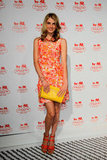 Model Angela Lindvall showed off her bright floral side in a seriously fun flower-power frock. To polish it off, she added orange sandals and a yellow clutch.