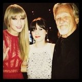 Zooey Deschanel and Kris Kristofferson presented Taylor Swift with an honour at the Billboard Music Awards. Source: Twitter user ZooeyDeschanel