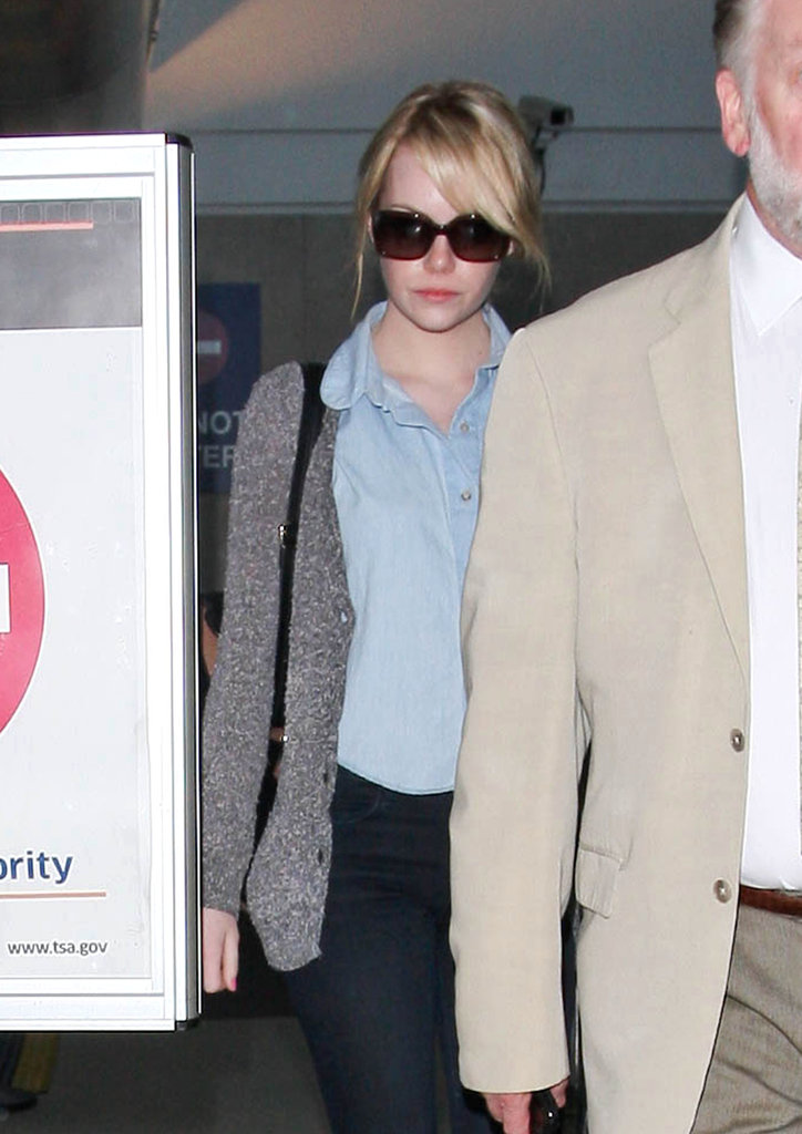 Emma Stone Returns to LA While Moviegoers Get an Extended Look at Spider-Man