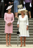 Kate Middleton and Camilla Parker Bowles both wore long-sleeved dresses and hats to the event.