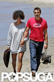 Halle Berry showed off her legs in an oversize sweater as she walked with Olivier Martinez.