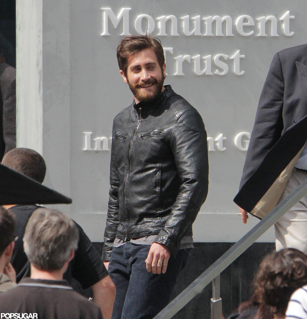 Jake Gyllenhaal smiled while wearing a leather jacket in Toronto.