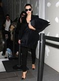 Kim Kardashian arrived back at LAX ready to celebrate.