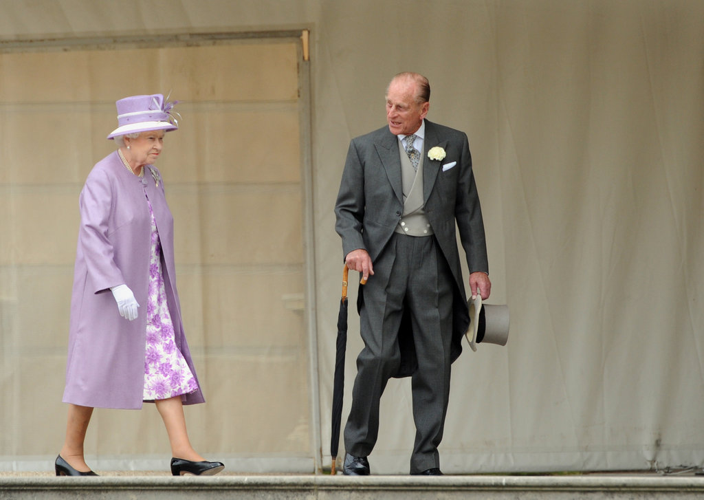 Queen Elizabeth II and Prince Philip walked together at Buckingham Palace.