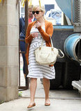 You definitely don't have to be pregnant to benefit from the comfort of flats, but Reese Witherspoon proved how stylish moms-to-be can be by pairing her cognac-colored flats with a matching cardigan and sweet striped dress.