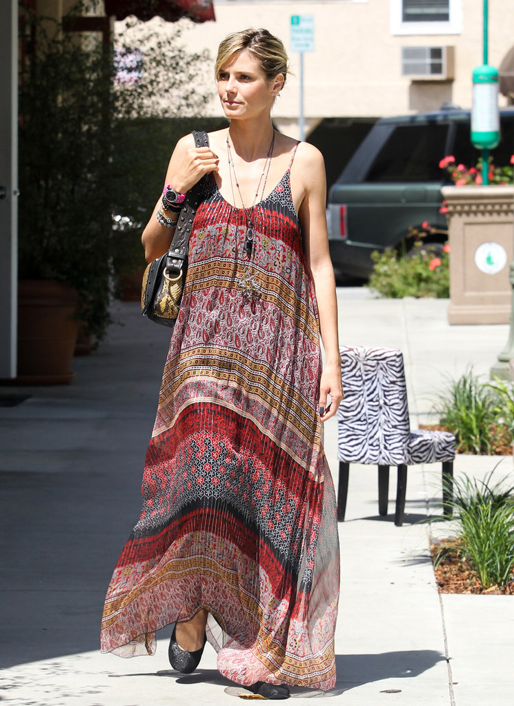 Heidi Klum made flats look bohemian-cool by pairing them with a billowy printed maxi dress.