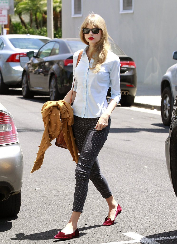 Taylor Swift paired her red loafers with cute polka-dot pants and a white button-down for a fresh, crisp daytime look.