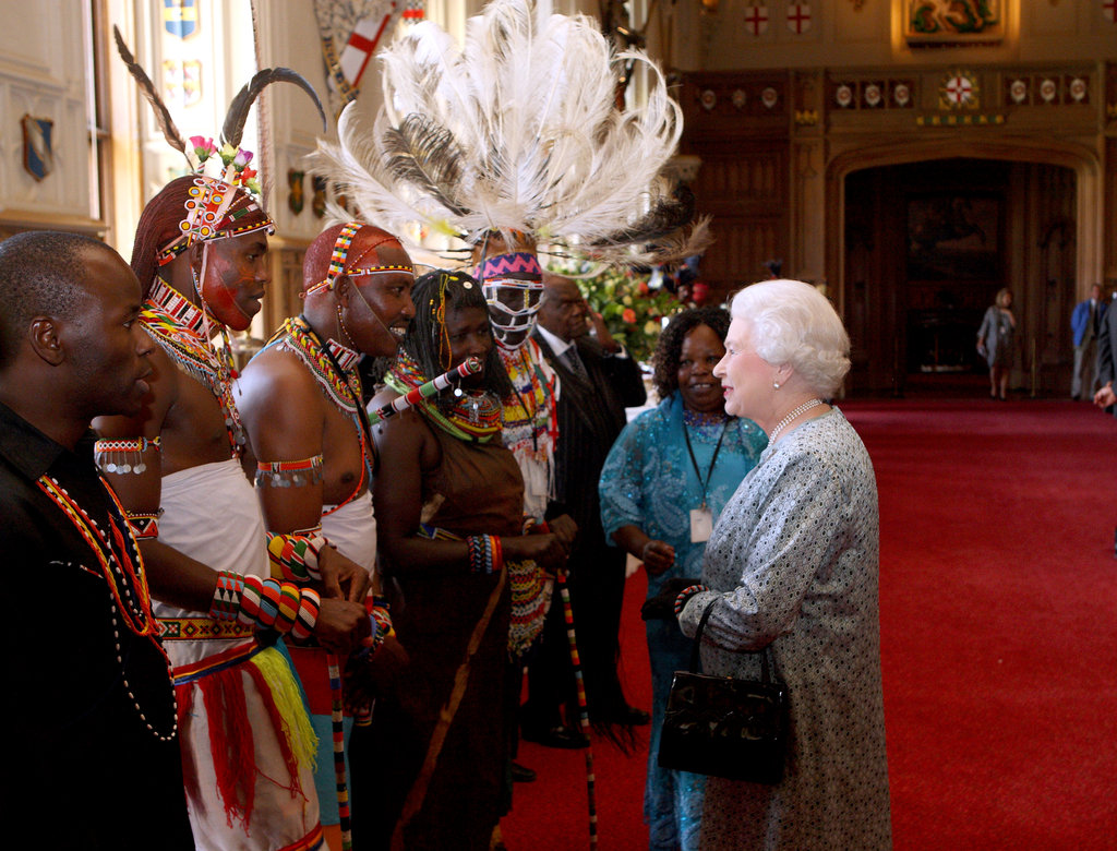Queen Elizabeth II met Kenyan tribesmen during a tea party for the cast of the Diamond Jubilee Pageant at Windsor Castle.