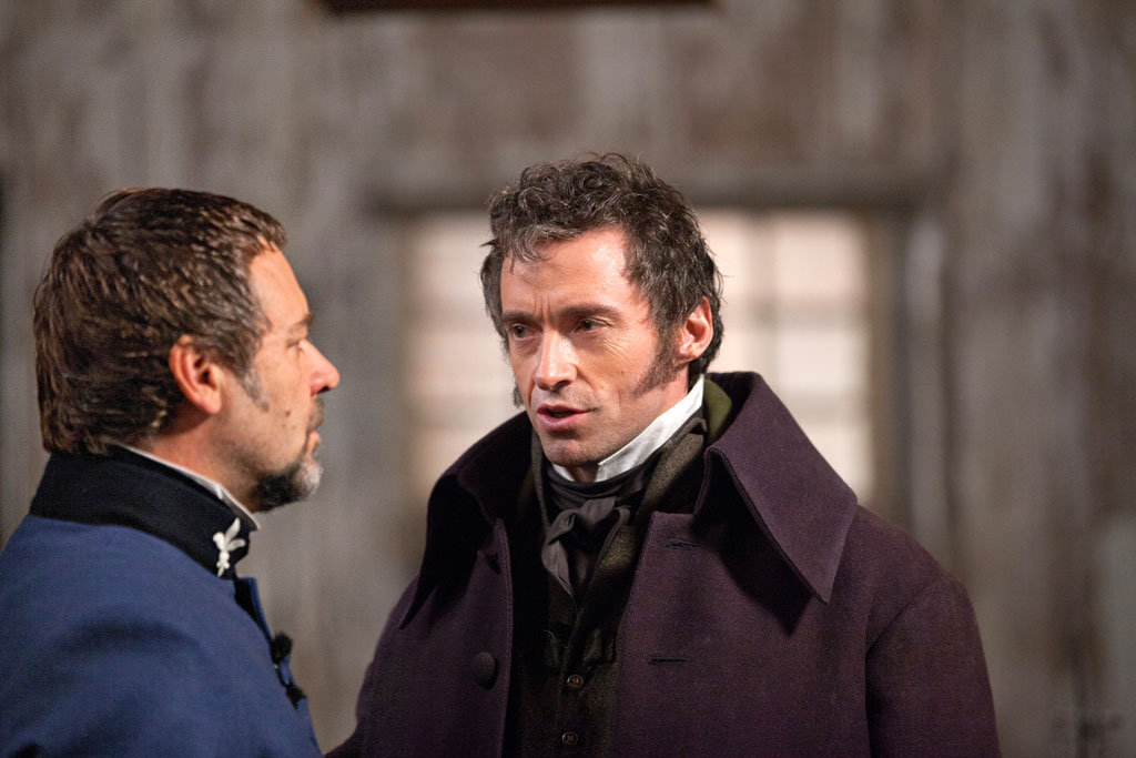 Hugh Jackman as Jean Valjean and Russell Crowe as Javert in Les Misérables.